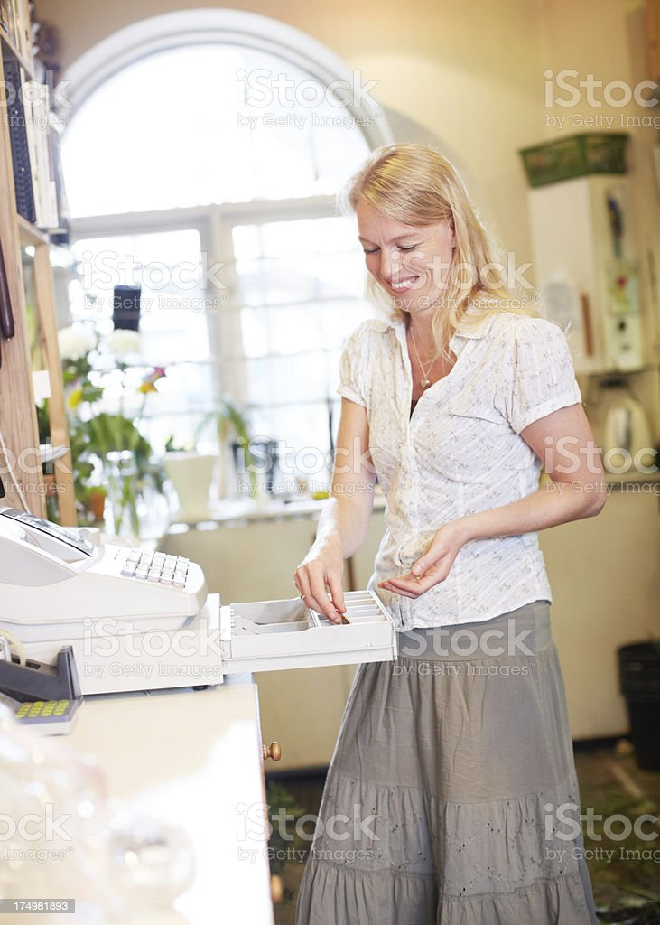 Cashing up the register stock photo