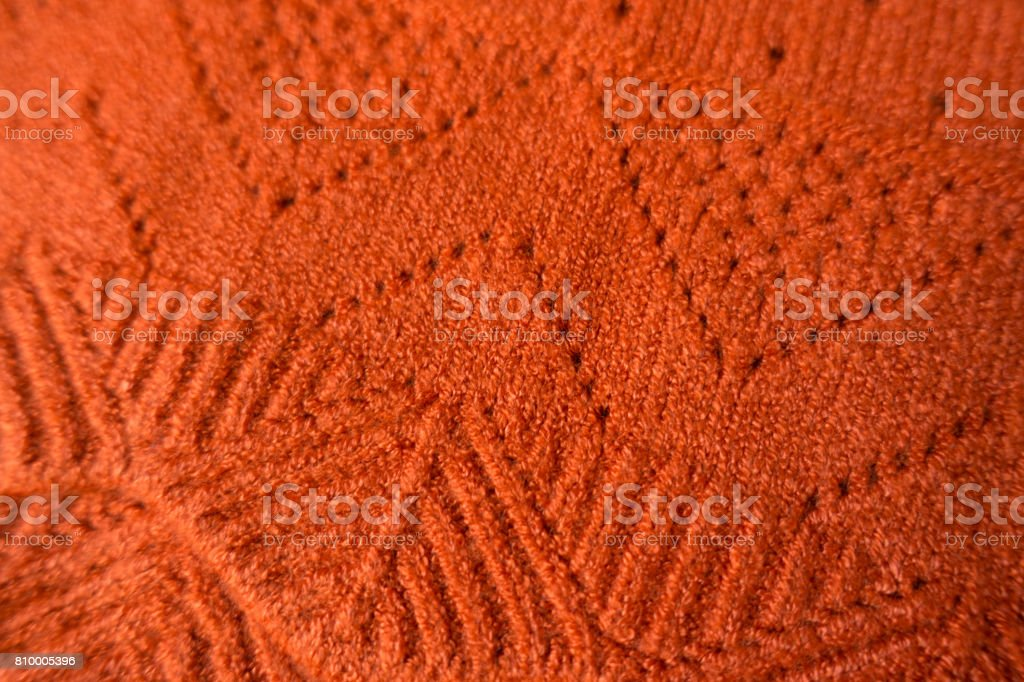 Cashmere fabric with geometric relief pattern and perforations stock photo