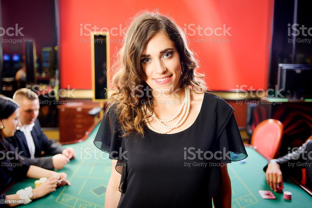 Casino: Beautiful Smiling Woman and Roulette Table stock photo
