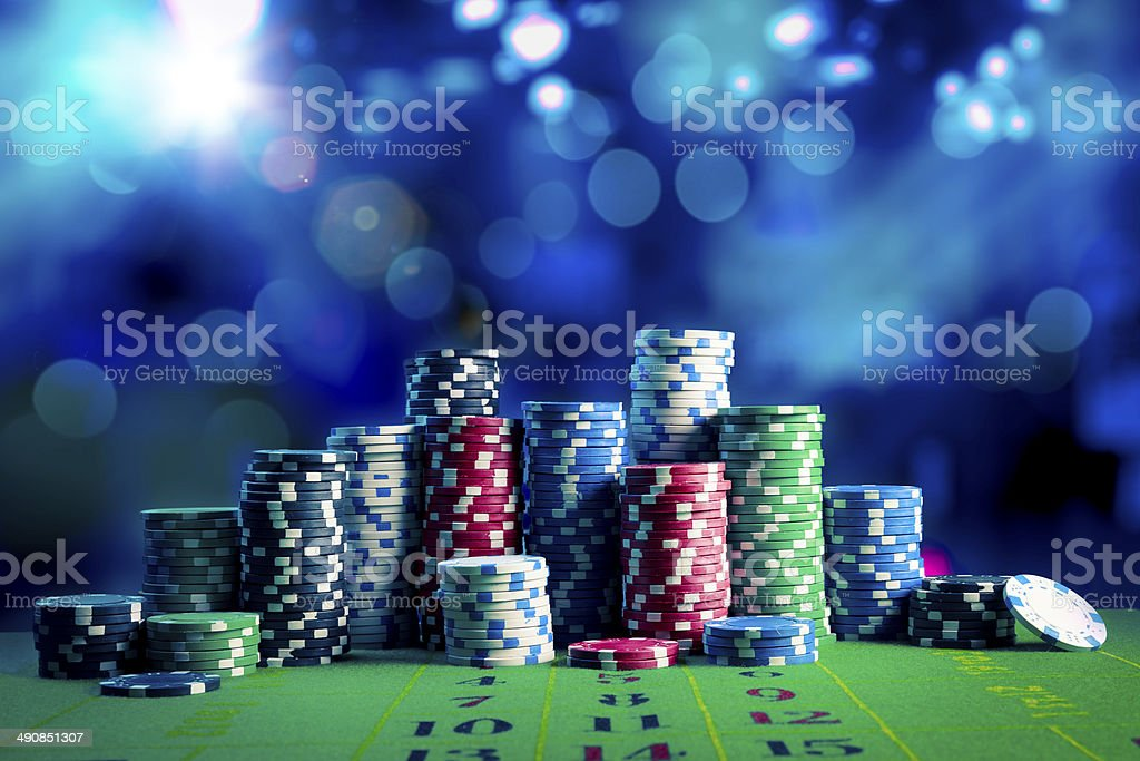 Casino chips with dramatic lighting and lens flares stock photo