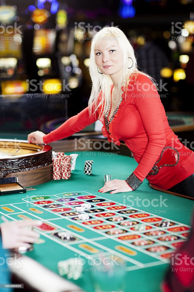 Casino dealer at the roullete table royalty-free stock photo
