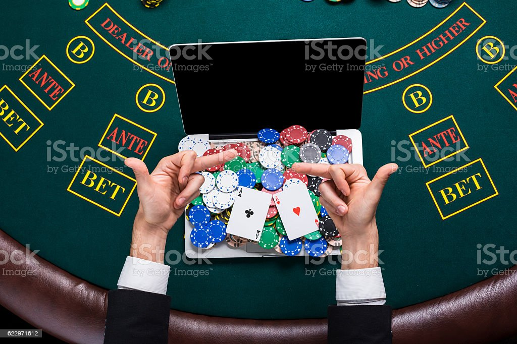 casino, online gambling, technology and people concept - close up stock photo