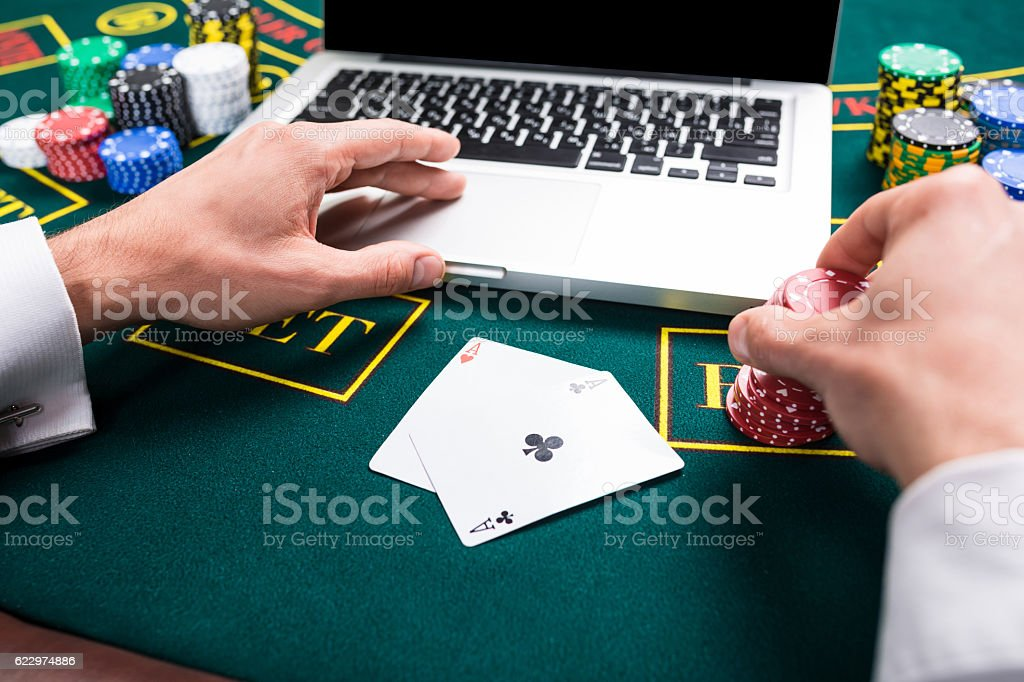 casino, online gambling, technology and people concept stock photo