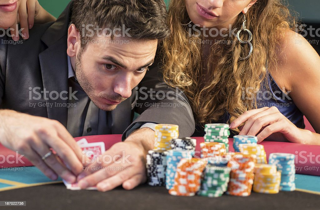 Casino. Poker Player Checking His Cards royalty-free stock photo