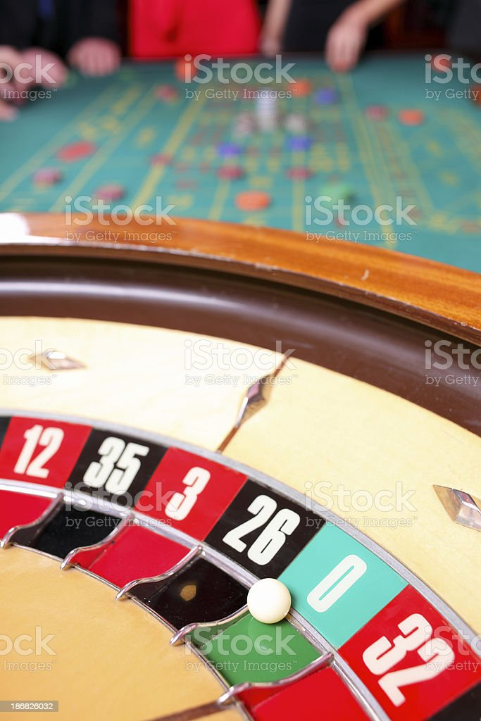 Casino roulette close up with the ball on 0. stock photo