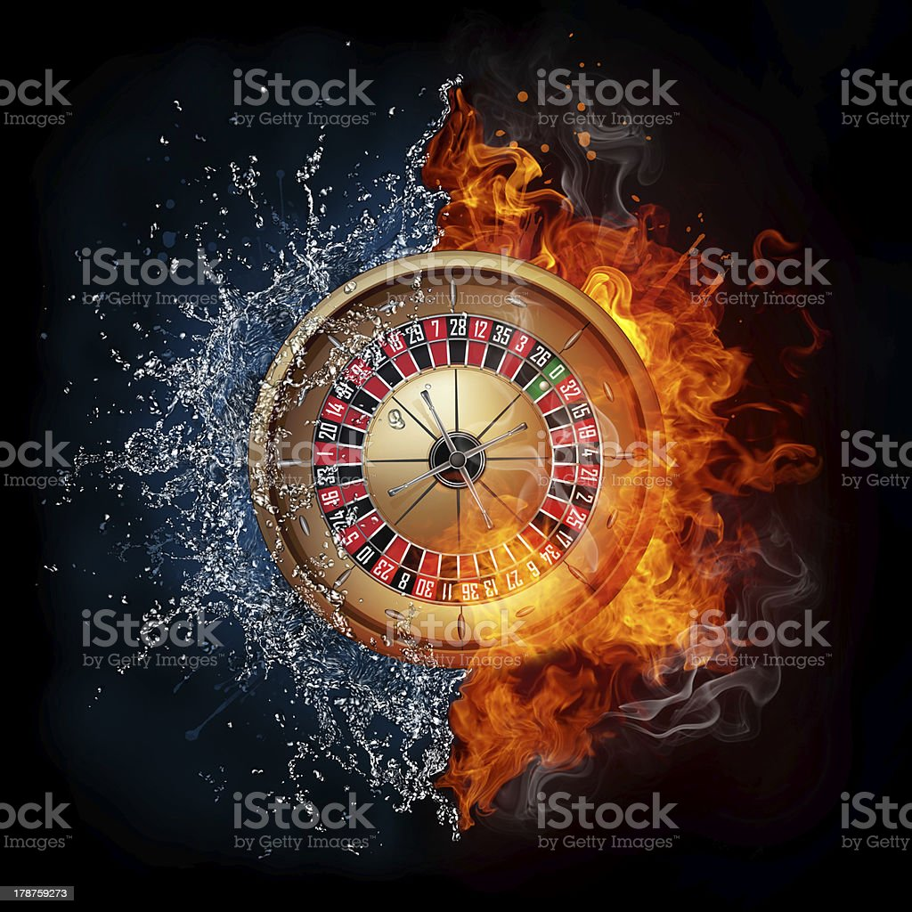Casino roulette game, half in water, half on fire royalty-free stock photo
