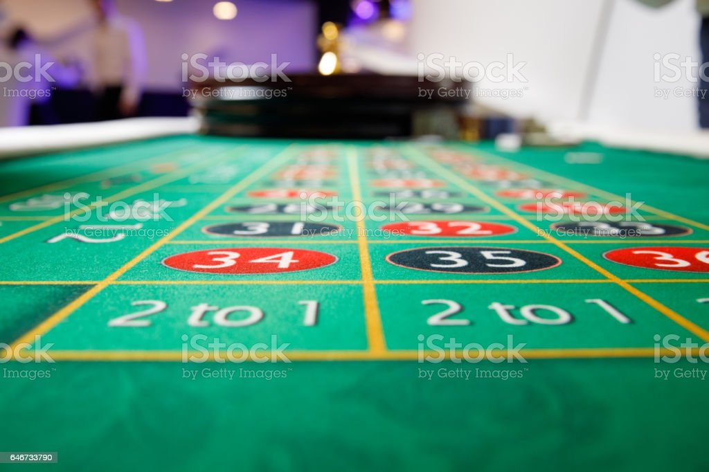 casino roulette green table stock photo