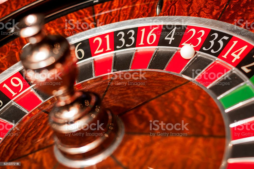 Casino roulette showing red 23 as the winning number stock photo