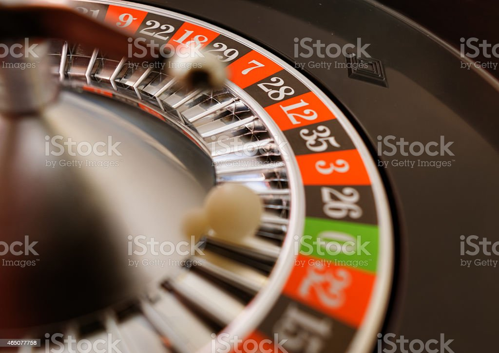 A casino roulette that has landed on 0 stock photo