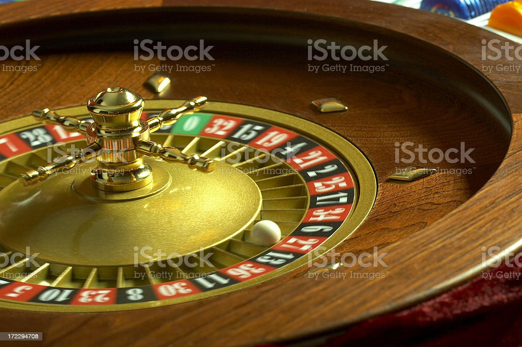 Casino roulette wheel spinning royalty-free stock photo