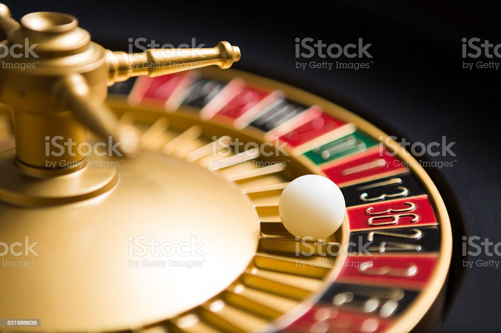 casino roulette wheel with the ball on number 36 stock photo