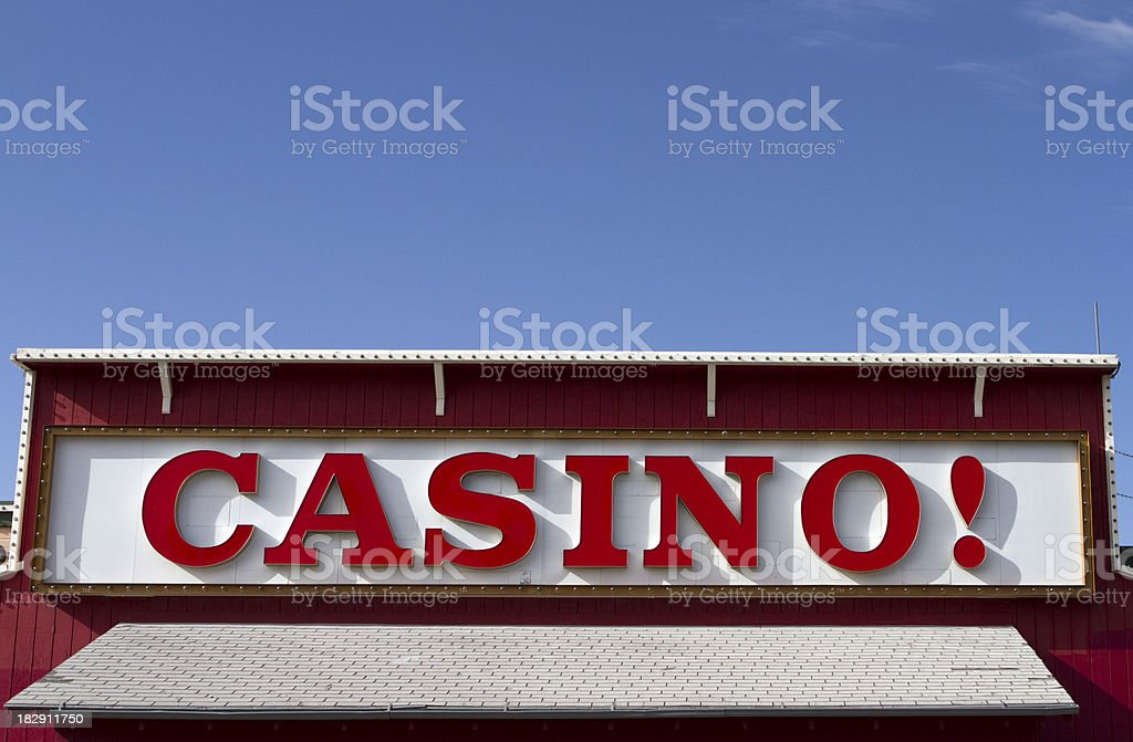 Casino Sign Against Bright Blue Sky stock photo