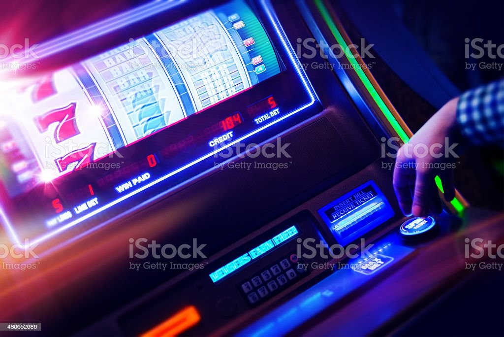 Casino Slot Machine Player stock photo