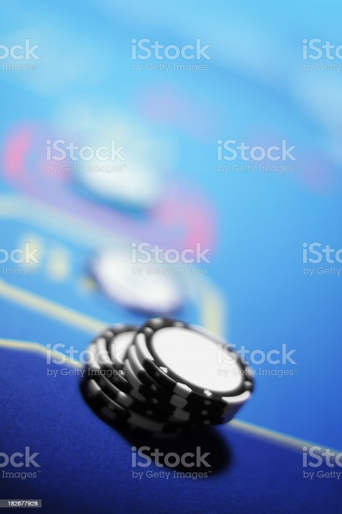 Casino table background with chips. Blue copyspace. Shallow depth of...