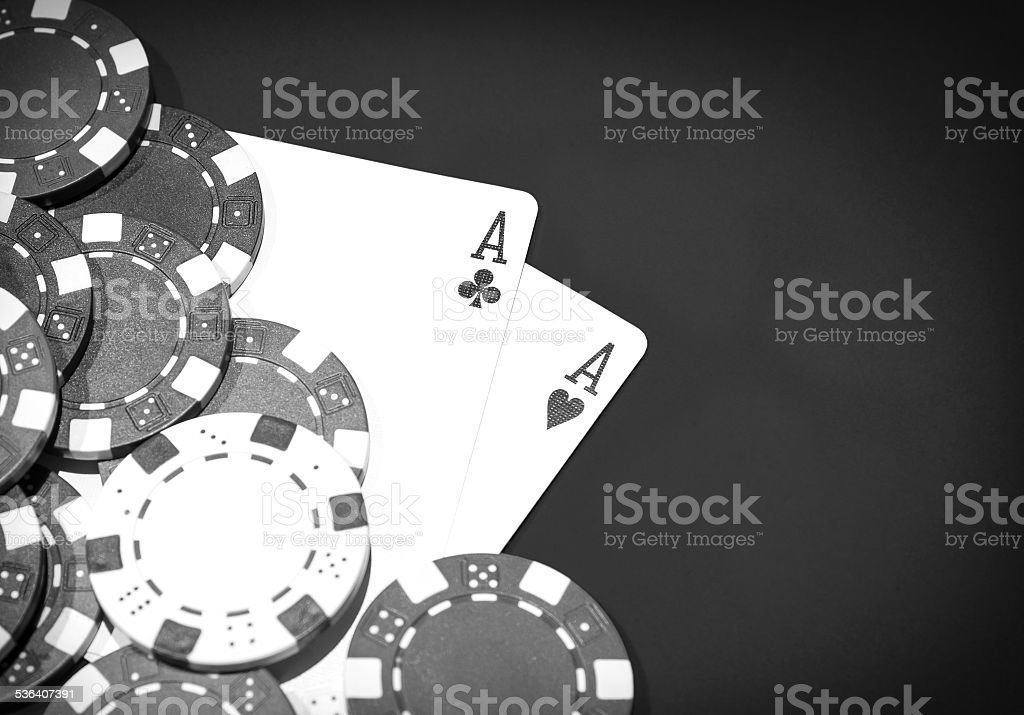 Casino table with a pair of aces and chips stock photo