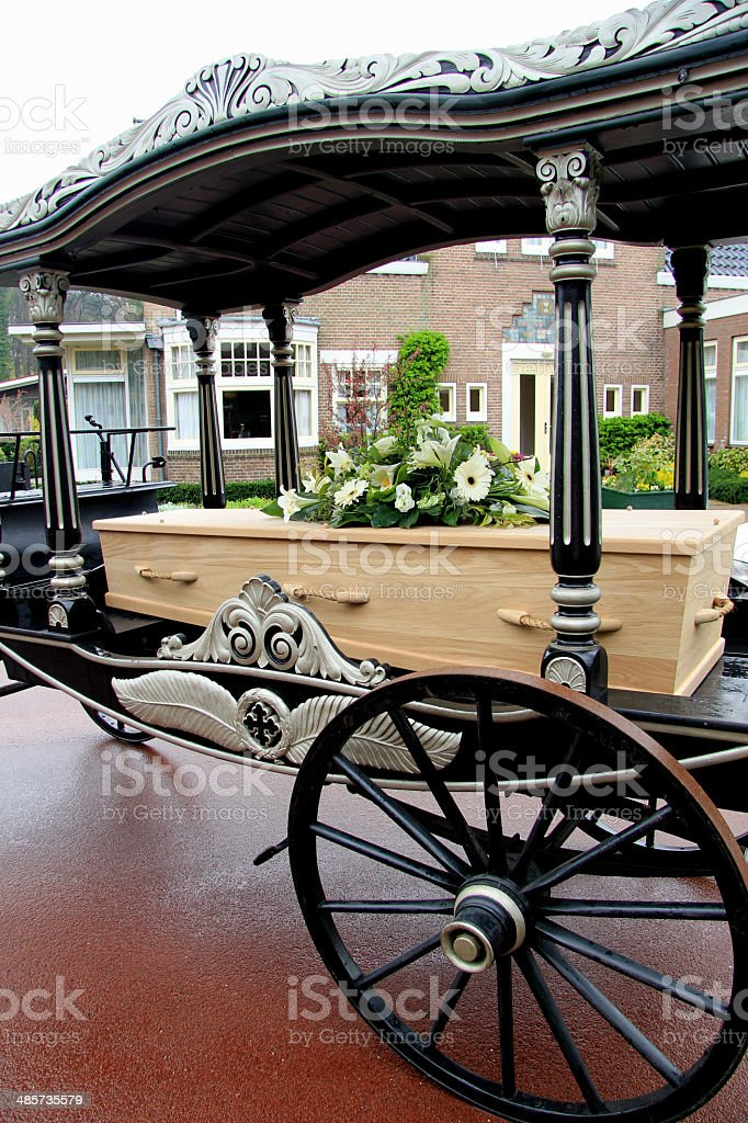Casket on a funeral carriage stock photo