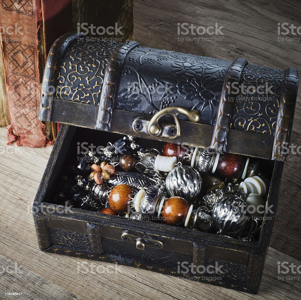 casket with jewelry and old book on a wooden surface royalty-free stock photo