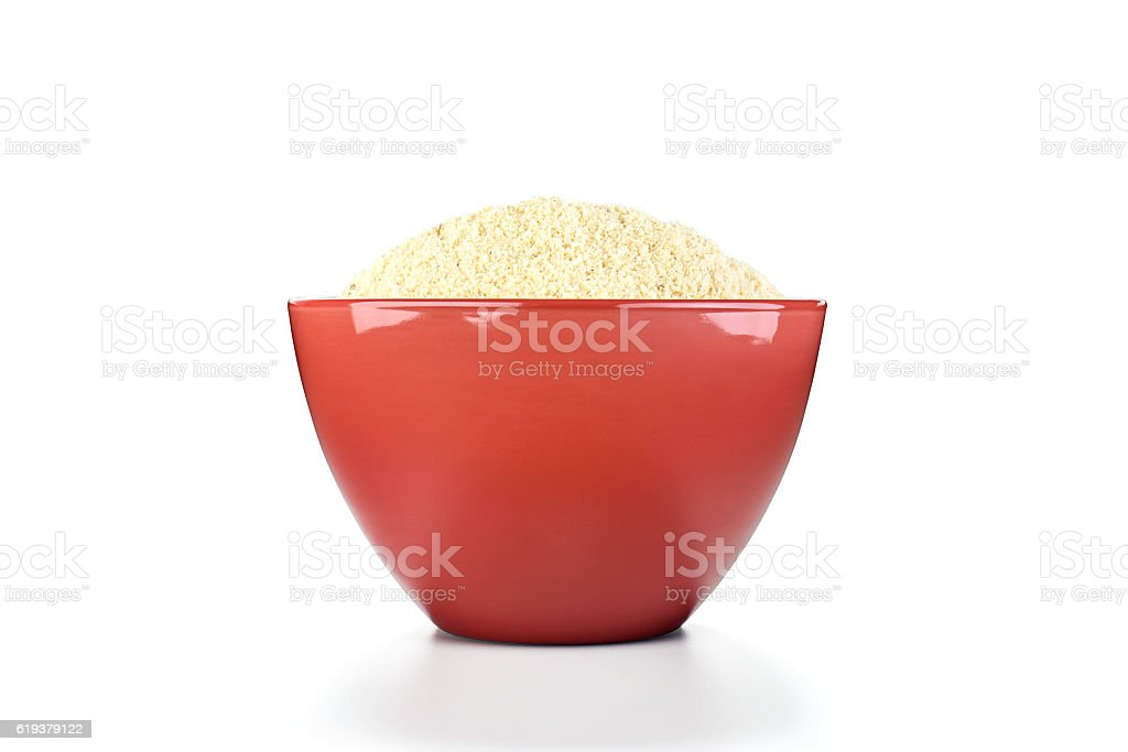cassava flour in red pot on white background stock photo