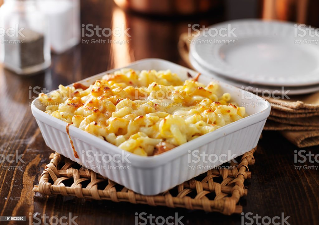 casserole dish with baked macaroni and cheese stock photo