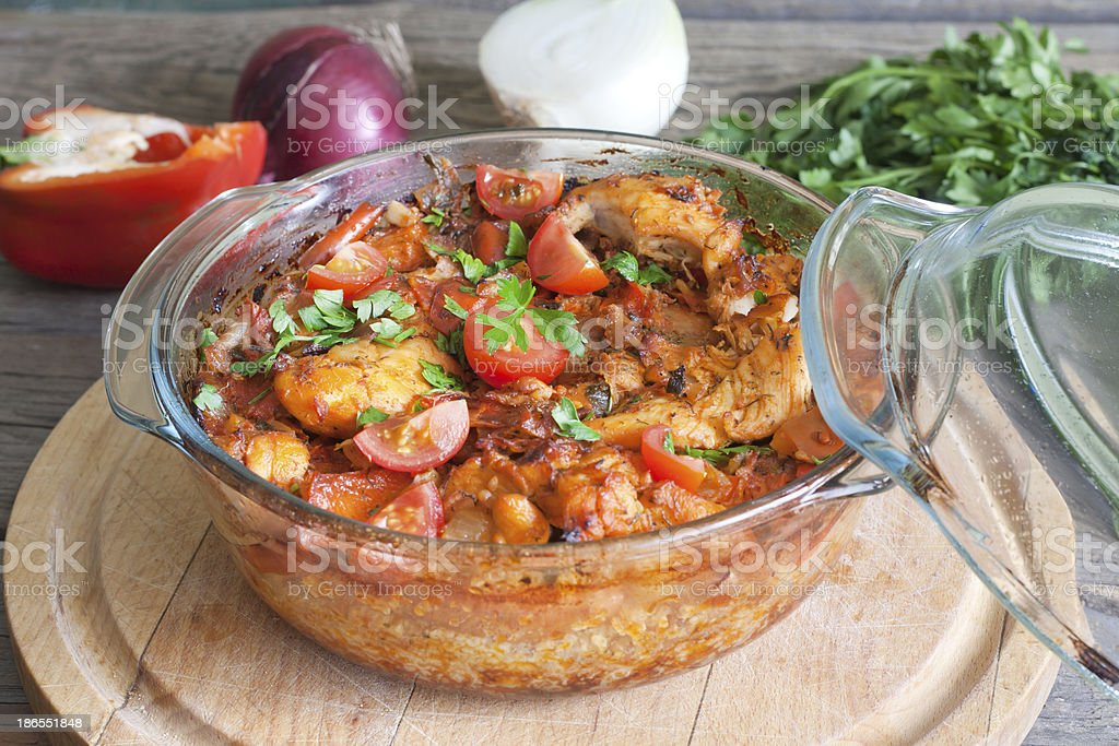 Casserole of chicken in an ovenproof dish stock photo