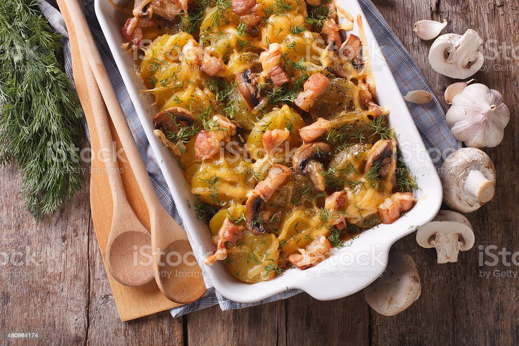 Casserole potato with bacon and mushrooms horizontal top view stock photo