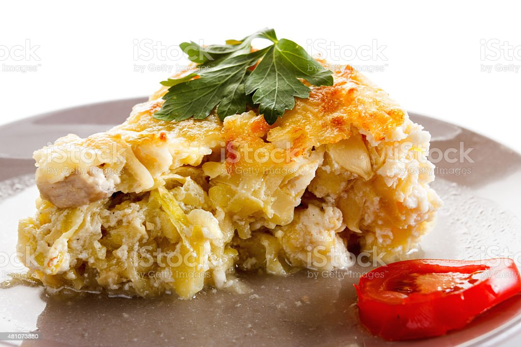 Casserole, squash and meat, fried with cheese, cottage cheese. stock photo