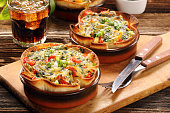 Casserole with cheese, spinach and tomatoes