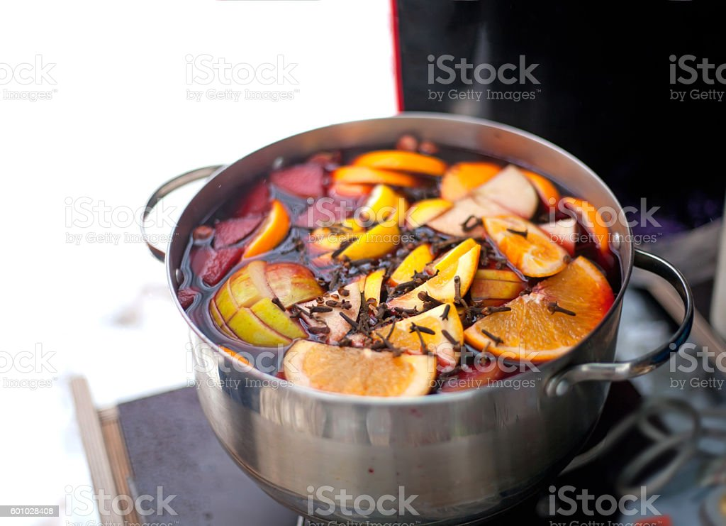 Casserole with hot wine, fruits and spices stock photo
