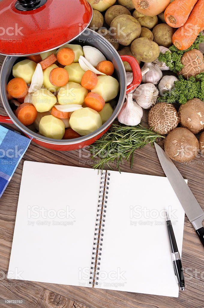 Casserole with organic vegetables and cookbook royalty-free stock photo