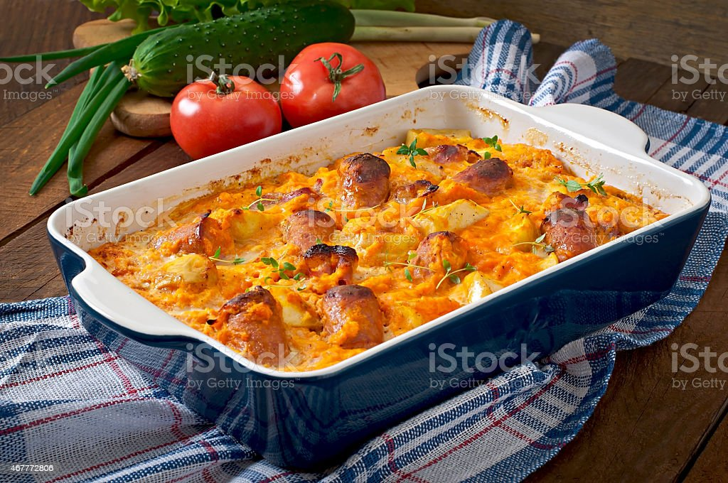 Casserole with sausage, bacon and apples stock photo