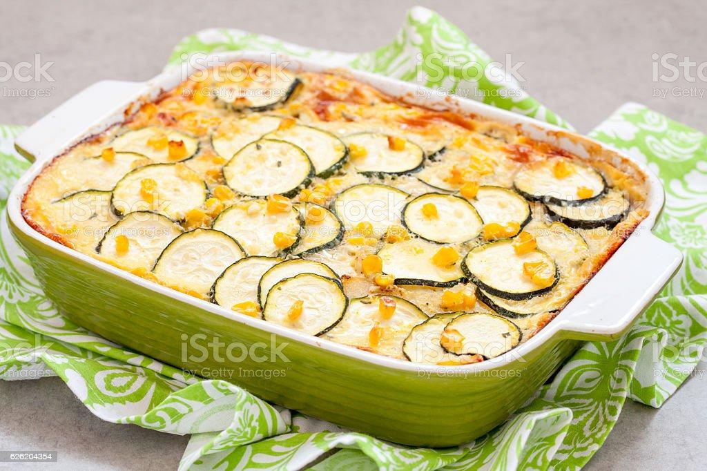 casserole with zucchini, corn and potato in baking dish stock photo
