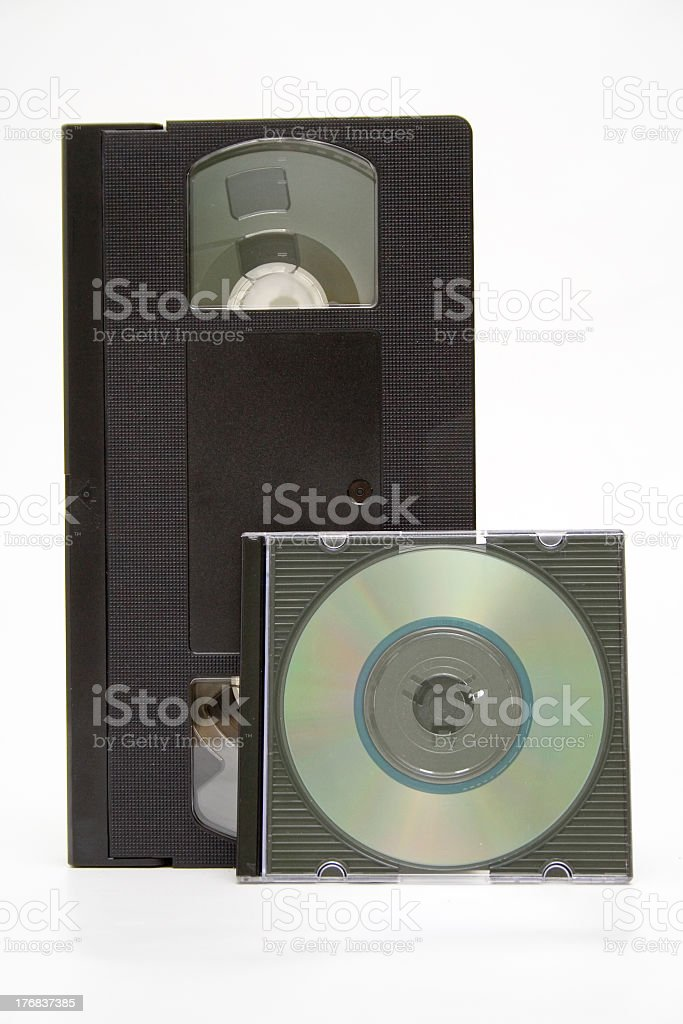 VHS cassette and CD disc on white background stock photo