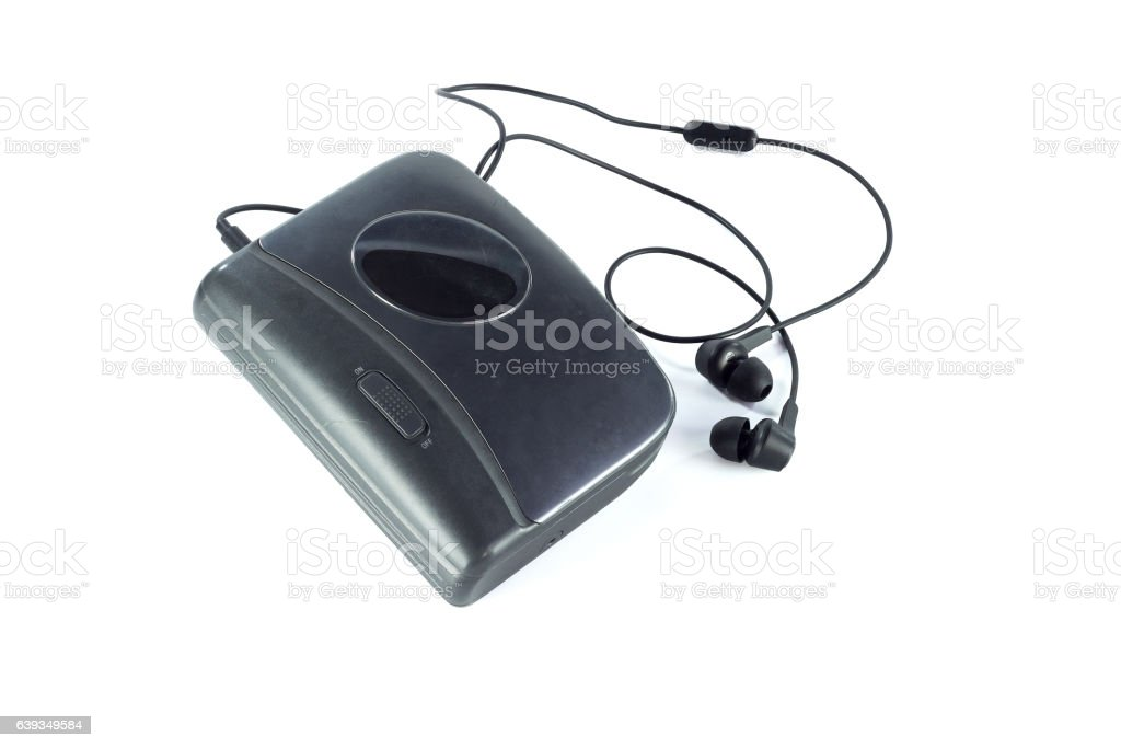 Cassette player and black earphones isolated stock photo
