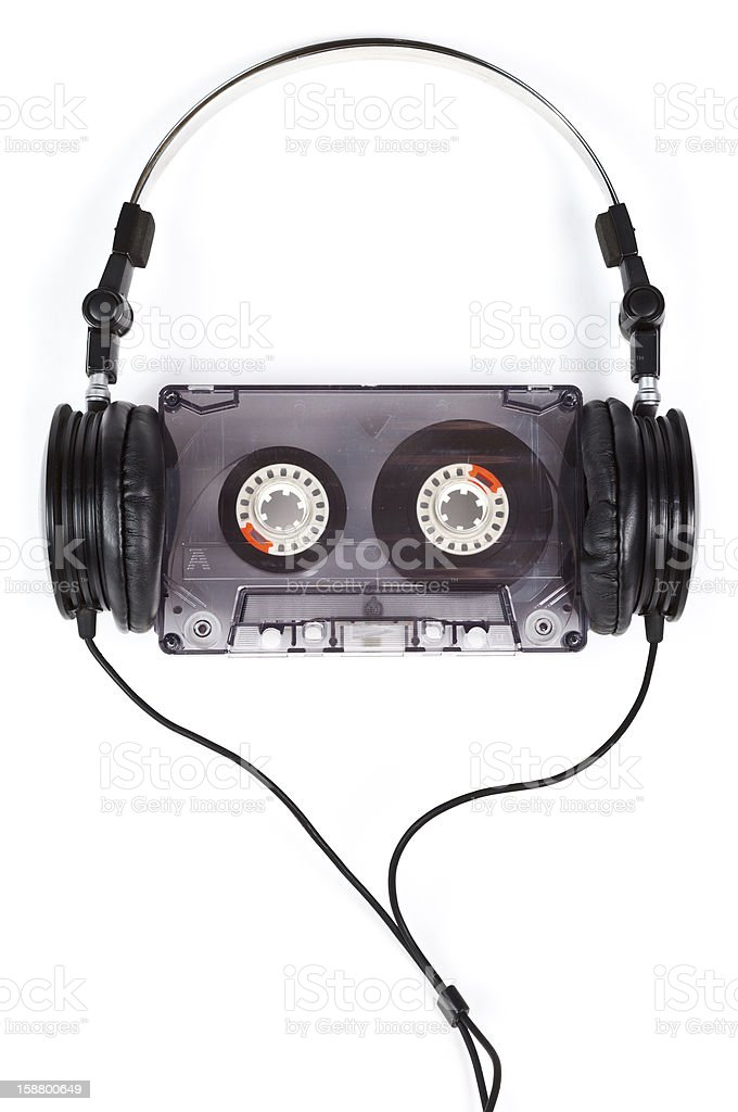 Cassette tape surrounded by over ear headphones stock photo