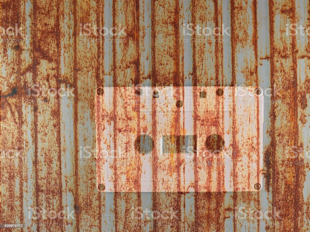cassette tape with grunge rusty metal retro background stock photo