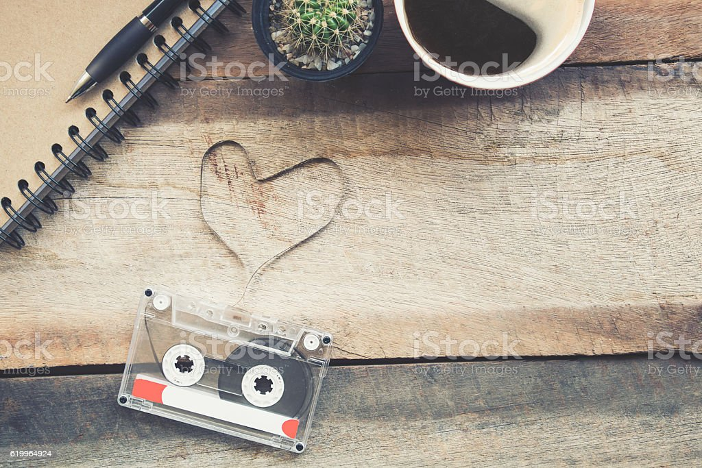 Cassette tapes shaping a heart on wooden table.vintage effect. stock photo