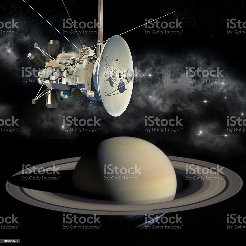 Cassini mission orbiter passing Saturn stock photo