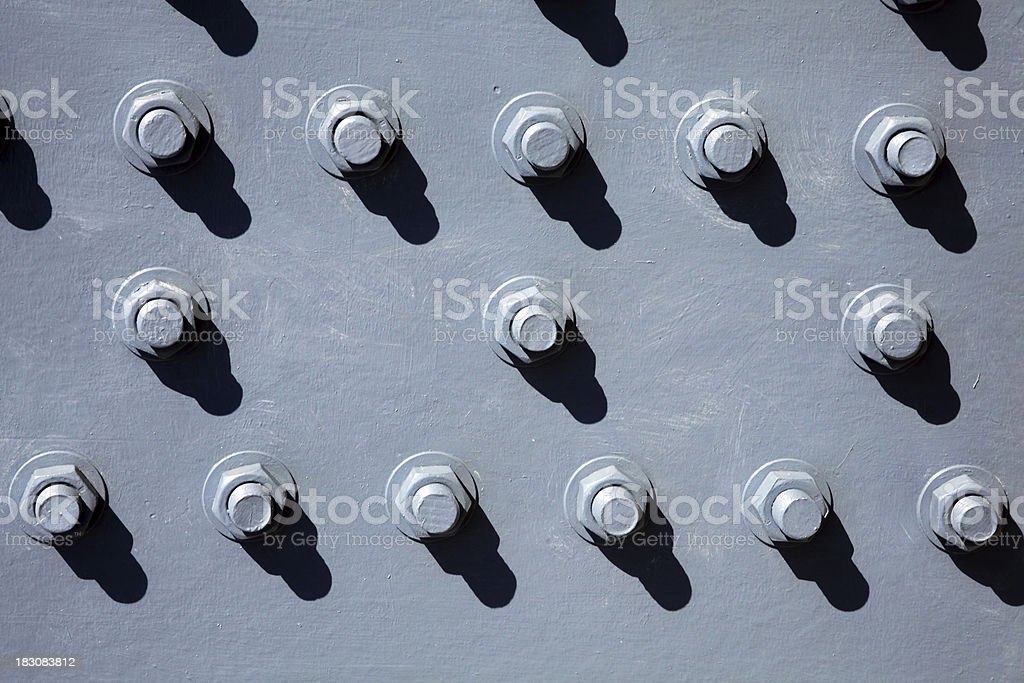 Cast Iron Background With Nuts And Bolts royalty-free stock photo