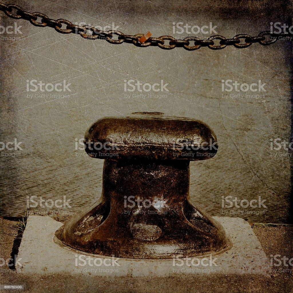 cast iron chain and bollard stock photo