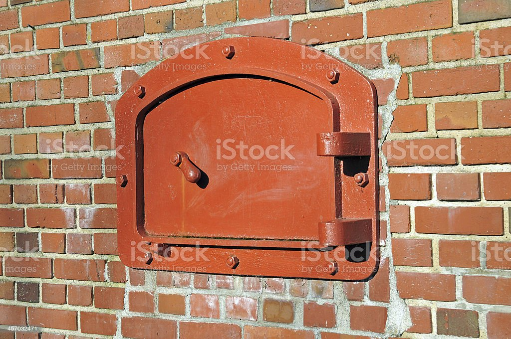 Cast iron clean-out frame and door for old incinerator royalty-free stock photo