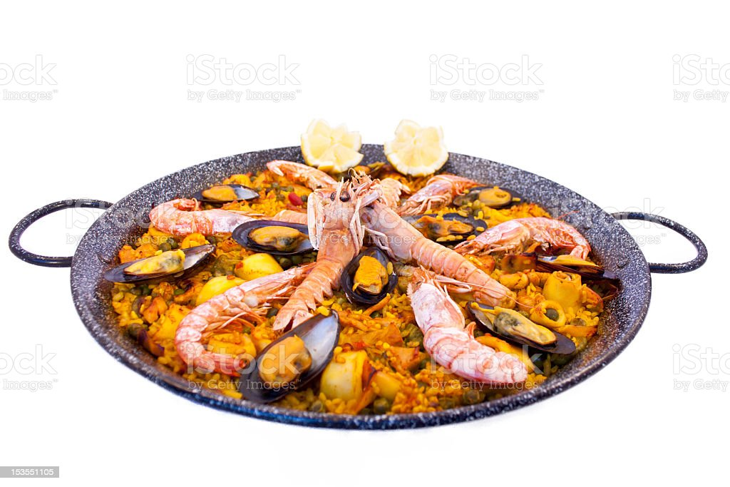Cast iron dish filled with delicious paella stock photo