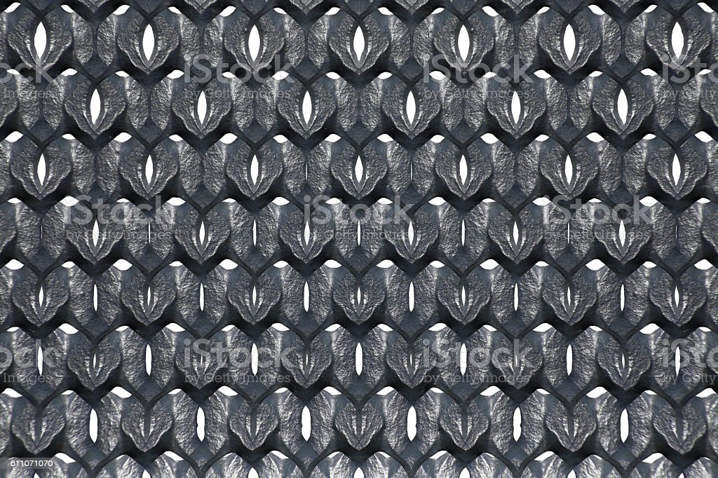 Cast iron fence with cellular structure. Abstract black-and-white material background stock photo