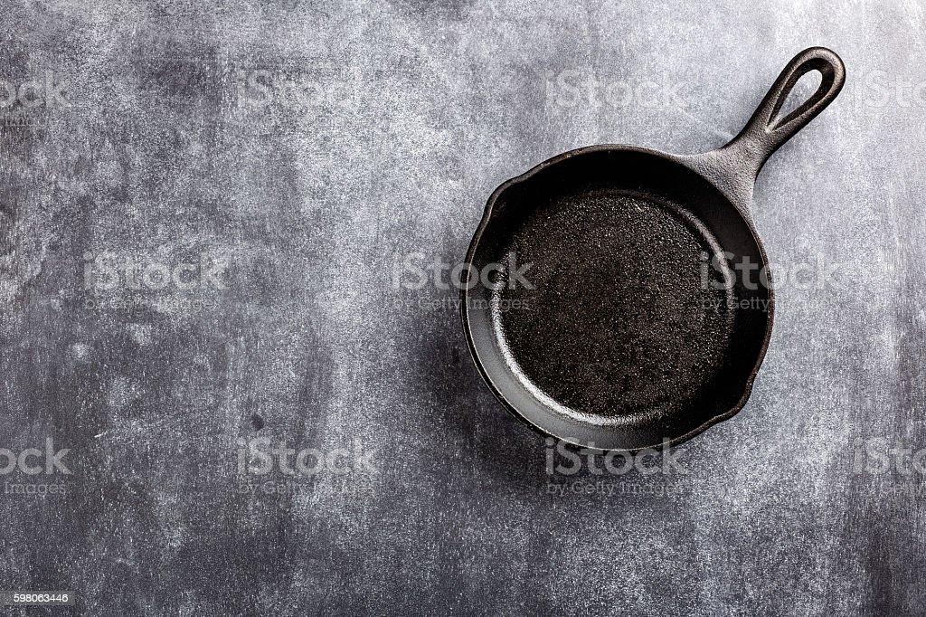 cast iron pan on dark background stock photo