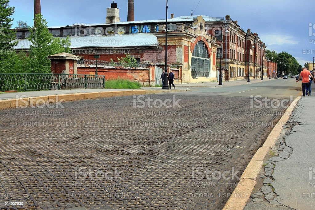 Cast iron paving and Machine school in Kronstadt, Russia stock photo