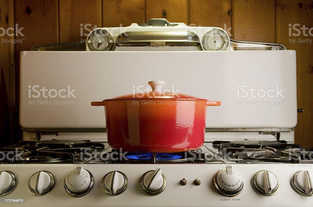 cast iron pot on stove stock photo