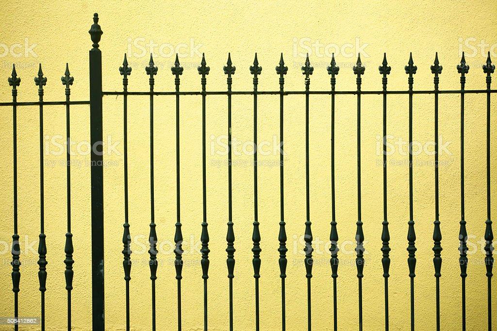 Cast iron railing and yellow wall stock photo