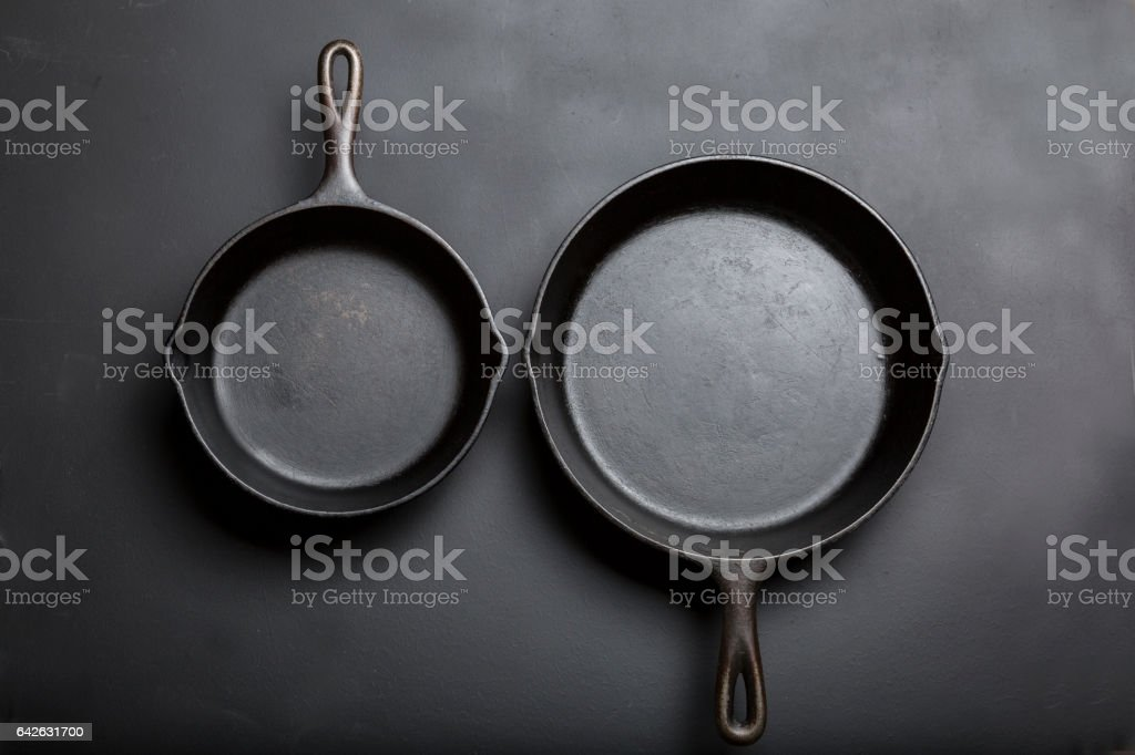 Cast Iron Skillet stacked side by side stock photo