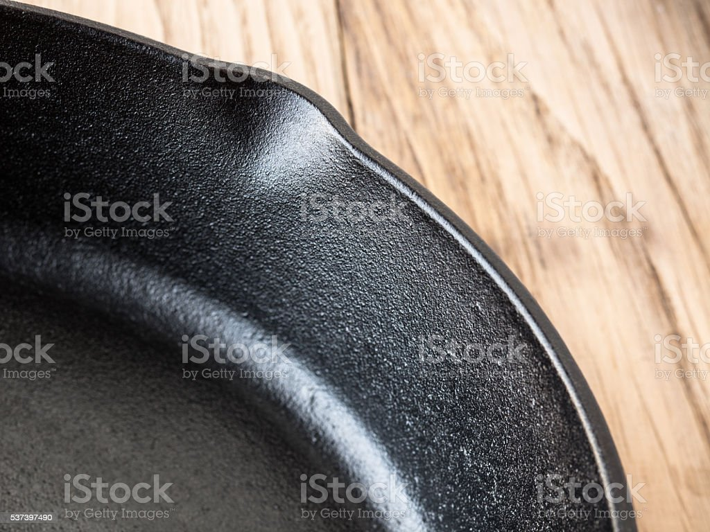 Cast iron skillet surface and rim stock photo