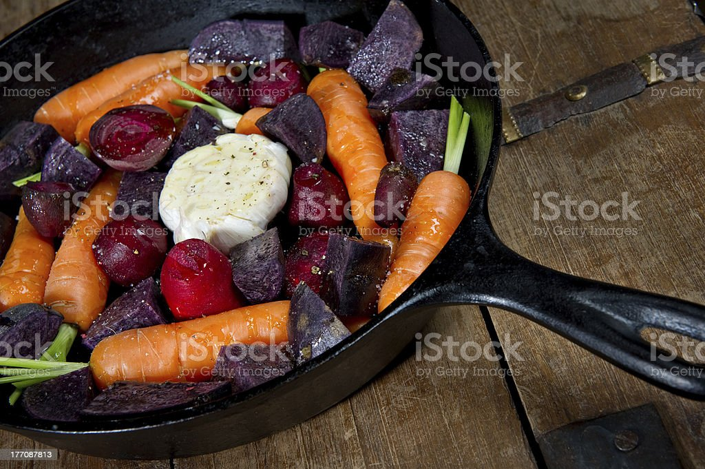 Cast Iron Skillet with raw vegetables stock photo