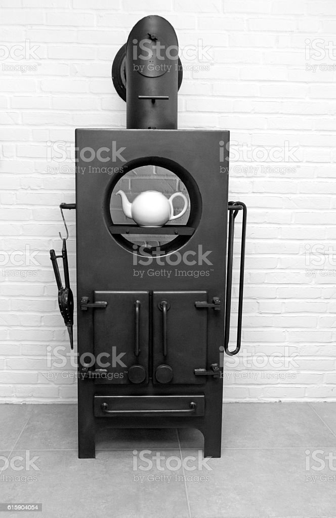 Cast iron wood stove with bellows, accessories and teapot stock photo